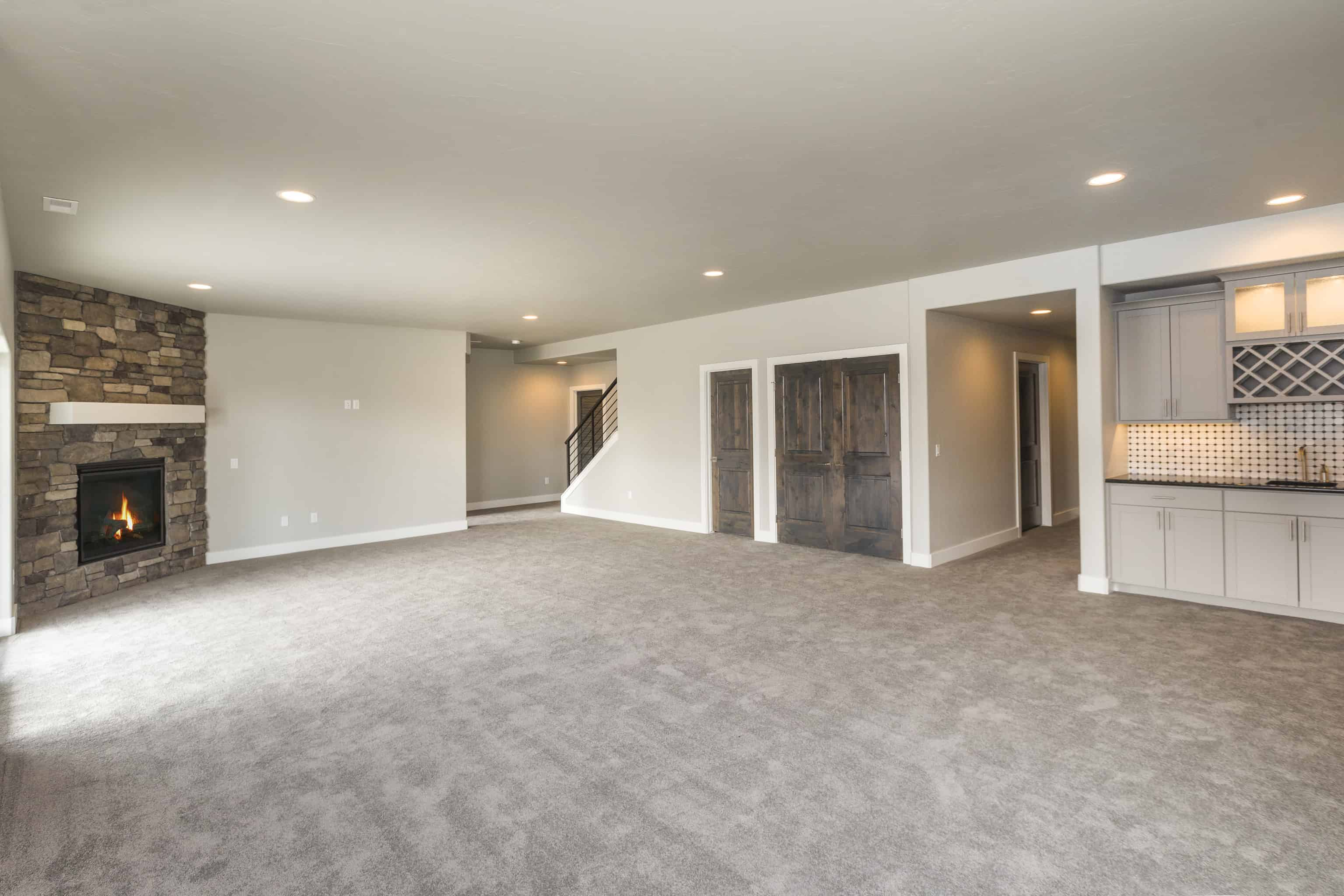 A remodeled basement with a freshly vacuumed floor